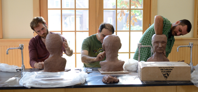 Clay workshop : 3 students working on sculp