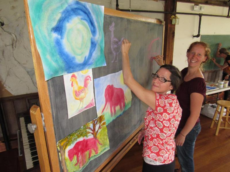 High school teachers Amy Kortus (left) and Emily Turner (right) practice their cartooning skills while taking a break from their Waldorf high school teacher training.